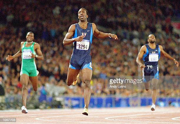 Michael Johnson of the USA crosses the line to win gold in Mens 400m Final at the Olympic Stadium on Day Ten of the Sydney 2000 Olympic Games in...