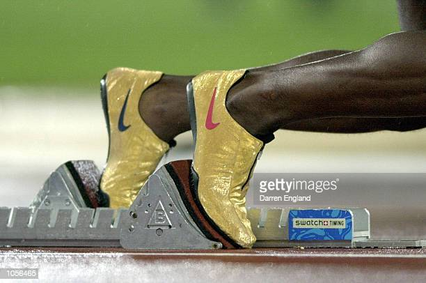 Michael Johnson of the USA prepares to leave the blocks in his Golden shoes in the Semi final of the Men's 400m at the Sydney 2000 Olympic Games held...