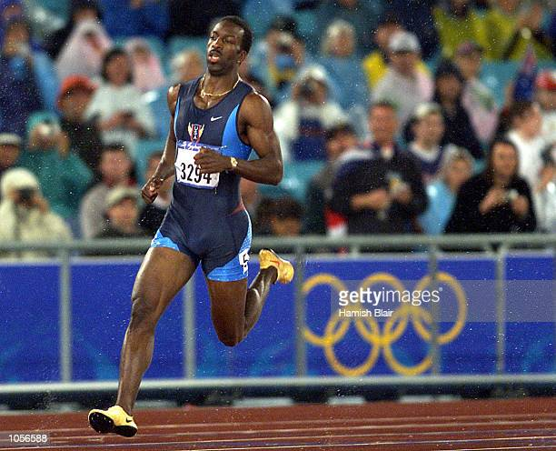 Michael Johnson of the USA qualifys for the 400m final during the Sydney 2000 Olympic Games at Olympic Stadium Sydney Olympic Park Sydney Australia...