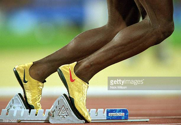 Michael Johnson of the USA rises from the blocks in the Mens 400m Final at the Olympic Stadium on Day Nine of the Sydney 2000 Olympic Games in Sydney...