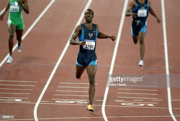 Michael Johnson of the USA runs during the Men's 400m Event at Olympic Stadium in the 200 Sydney Olimpic Games in Sydney Australia Michael Johnson...