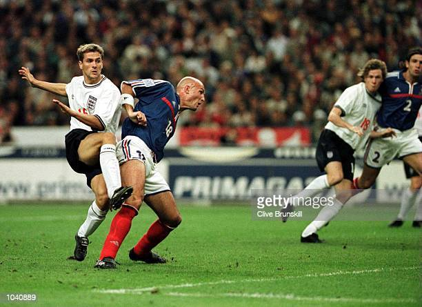 Michael Owen of England scores the equalising goal during the France v England Nationwide International Friendly from the Stade de France Paris...