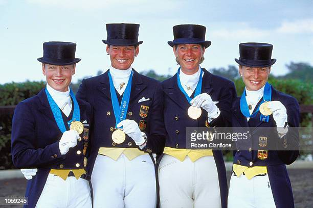 Nadine Capellmann Ulla Salzgeber Alexandra Simons de Ridder and Isabell Werth of Germany celebrate Gold in the Team Dressage at the Sydney...