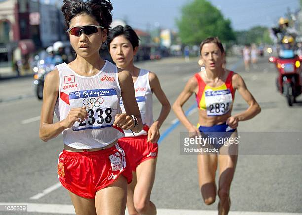 Naoko Takahashi of Japan breaks away from the pack to win the Womens Marathon on Day Nine of the Sydney 2000 Olympic Games in Sydney Australia...