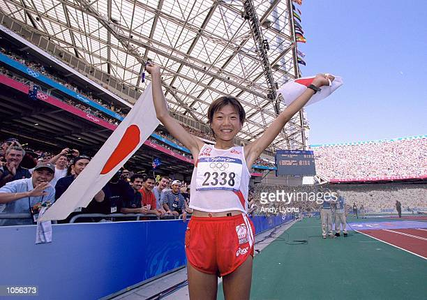 Naoko Takahashi of Japan celebrates her win in the Womens Marathon on Day Nine of the Sydney 2000 Olympic Games in Sydney Australia Mandatory Credit...