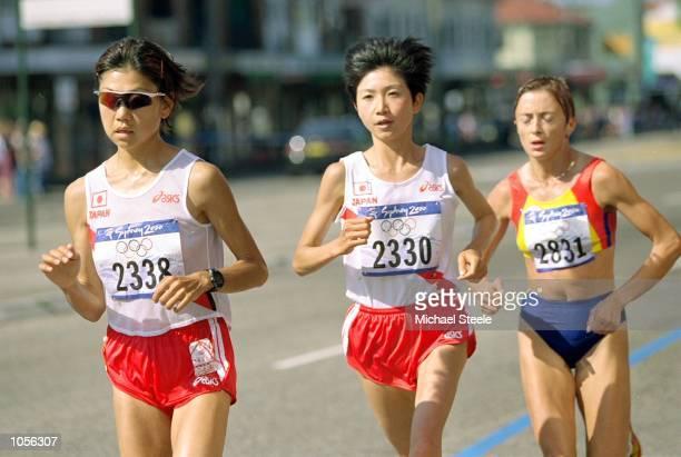 Naoko Takahashi of Japan compatriot Ari Ichihashi and Lidia Simon of Romania in action during the Womens Marathon on Day Nine of the Sydney 2000...