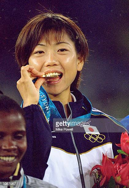 Naoko Takahashi of Japan on the podium after winning gold in the Womens Marathon at the Olympic Stadium on Day Nine of the Sydney 2000 Olympic Games...