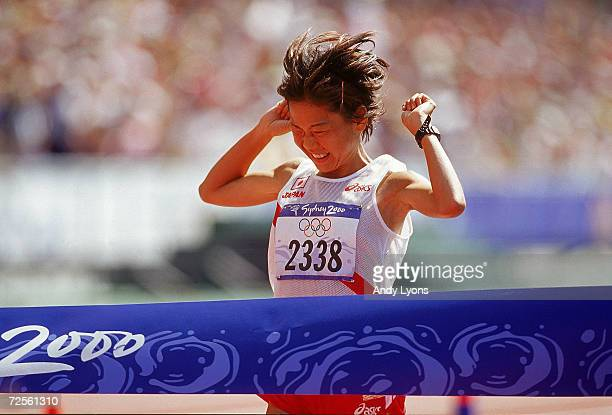 Naoko Takahashi of Japan takes the tape to win the Womens Marathon on Day Nine of the Sydney 2000 Olympic Games in Sydney Australia Mandatory Credit...