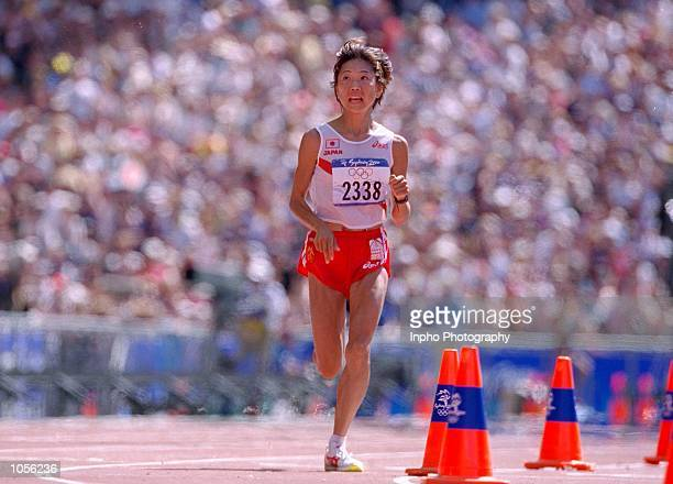 Naoko Takahashi of Japan wins the Womens Marathon on Day Nine of the Sydney 2000 Olympic Games in Sydney Australia Mandatory Credit Billy Stickland...
