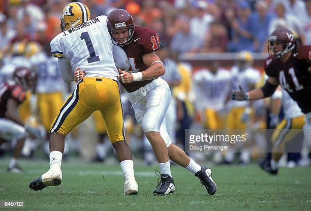 Nick Sorensen of the Virginia Tech Hokies tackles Butchie Washington of the Akron Zips during a game at Lane Stadium in Blackburg Virginia The Hokies...