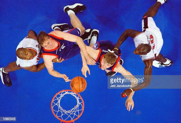Nikita Morgunov and Alexandre Bachminov of Russia battle with Vin Baker and Kevin Garnett of Russia for a rebound during the Mens Basketball...