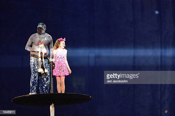 Nikki Webster and Djakapurra Munyarryan perform during the Opening Ceremony of the Sydney 2000 Olympic Games at the Olympic Stadium in Homebush Bay,...