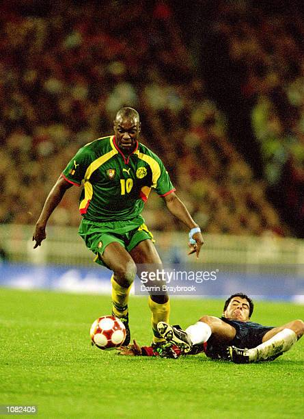 Patrick Mboma of Cameroon leaves the Chile defence trailing during the Sydney 2000 Olympic Games Mens Football Semi Final played at the MCG in...