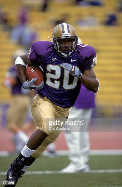 Paul Arnold of the Washington Huskies runs with the ball full speed downfield during the game against the Idaho Vandals at Husky Stadium in Seattle...