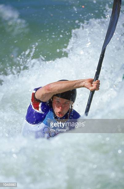 Paul Ratcliffe of Great Britain in action during whitewater canoe training at the Penrith Whitewater Centre before the Sydney 2000 Olympic Games in...