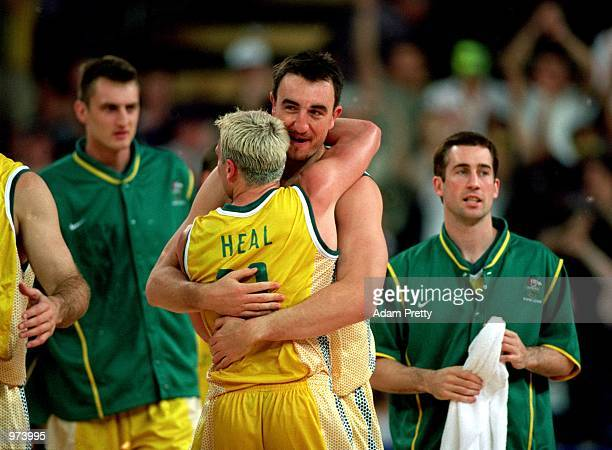 Paul Rogers and Shane Heal of Australia celebrate after their win against Russia during the Men's Basketball match between Australia and Russia held...