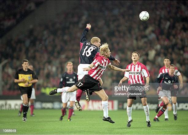 Paul Scholes of Manchester United wins the ball in the air during the UEFA Champions League Group G match against PSV Eindhoven played at the Philips...
