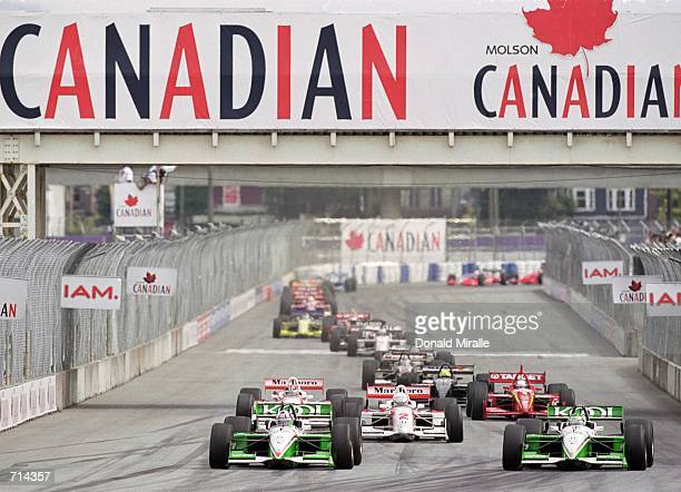 Paul Tracy of Canada who drives a Honda Reynard 2KI for Team KOOL Green and Dario Franchitti of Scotland who drives a Honda Reynard 2KI for Team KOOL...