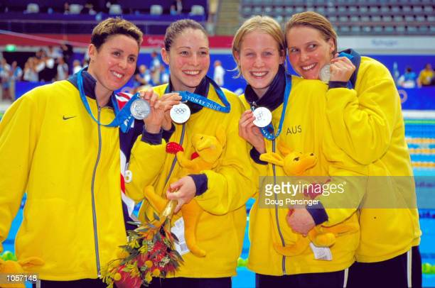 Petria Thomas Kirsten Thomson Giaan Rooney and Susie O''Neill of Australia celebrate Silver in the Womens 4x200m Freestyle Relay Final at the Sydney...