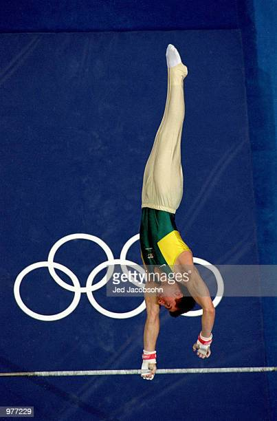 Philippe Rizzo of Australia in action on the High Bar during the Men's Gymnastics Final held at the Sydney Superdome during the Sydney 2000 Olympics...