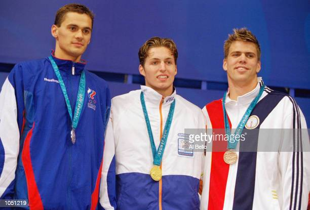 Pieter van den Hoogenband of the Netherlands wins gold in the Men's 100m Freestyle Final beating silver medallist Alexander Popov of Russia and...