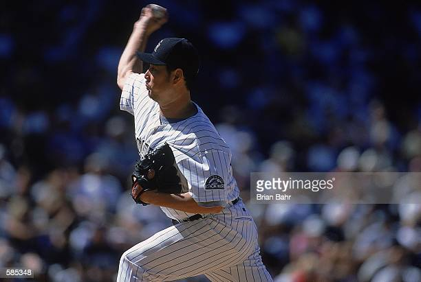 Pitcher Masato Yoshii of the Colorado Rockies gets ready to pitch the ball during the game against the Milwaukee Brewers at Coors Field in Denver...