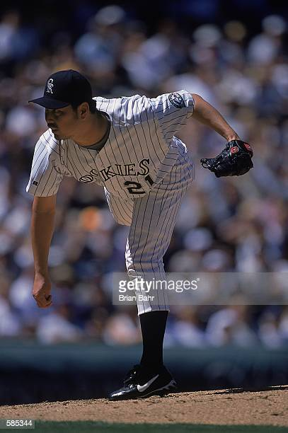 Pitcher Masato Yoshii of the Colorado Rockies pitches the ball during the game against the Milwaukee Brewers at Coors Field in Denver Colorado The...