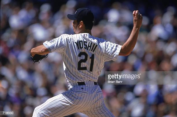 Pitcher Masato Yoshii of the Colorado Rockiesthrows the ball during the game against the Milwaukee Brewers at Coors Field in Denver Colorado The...