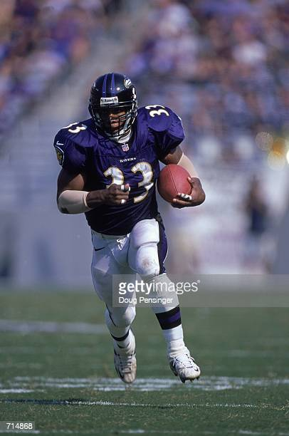 Priest Holmes of the Baltimore Ravens runs with the ball during the game against the Jacksonville Jaguars at Psinet Stadium in Baltimore Maryland The...