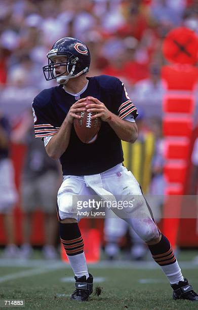 Quarterback Cade McNown of the Chicago Bears looks to pass the ball during the game against the Tampa Bay Buccaneers at the Raymond James Stadium in...
