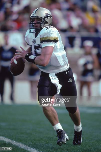QuarterbackDrew Brees of the Purdue Boilermakers moves with the ball during the game against the Notre Dame Fighting Irish at the Notre Dame Stadium...