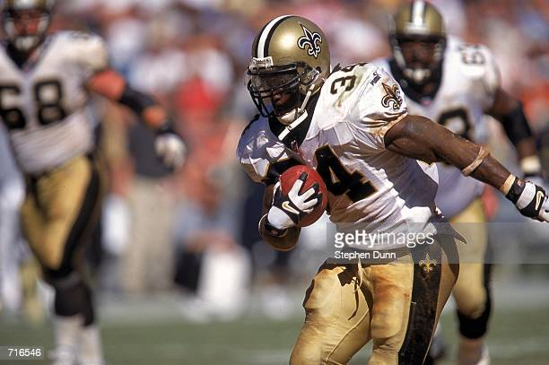 Ricky Williams of the New Orleans Saints carries the ball as he makes a touchdown run during a game against the San Diego Chargers at Qualcomm...
