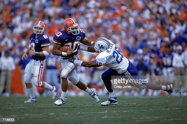 Robert Gillespie of the Florida Gators carries the ball as he is tackled by David Johnson Morris Lane of the Kentucky Wildcats at the Ben Hill...