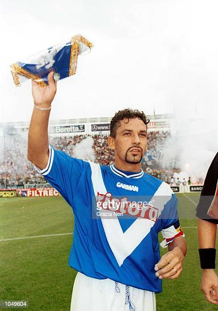Roberto Baggio of Brescia lines up at the start of the match during his debut in the Coppa Italia first leg match between Brescia and Juventus played...