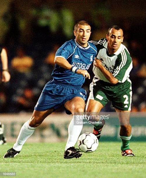 Roberto Di Matteo of Chelsea is chased by Guido of St Gallen during the UEFA Cup first round first leg game between Chelsea and St Gallen at Stamford...