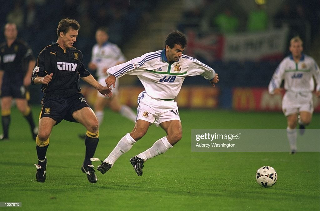 Roberto Martinez of Wigan Athletic shields the ball from Duncan Jupp of Wimbledon during the Worthington Cup Second round first leg match at Selhurst Park, in London. The match ended in a 0-0 draw. \ Mandatory Credit: Aubrey Washington /Allsport