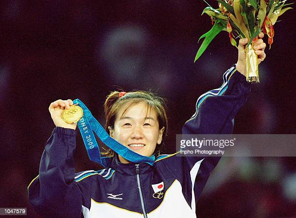 Ryoko Tamura of Japan celebrates gold in the Women's 48kg Judo event at the Exhibition Halls in Darling Harbour on Day Two of the Sydney 2000 Olympic...