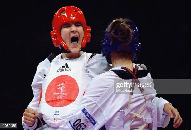 Sarah Stevenson of Great Britain battles with Trude Gundersen of Norway in the Womens 67kg Taekwondo at the State Sports Centre on Day 14 of the...