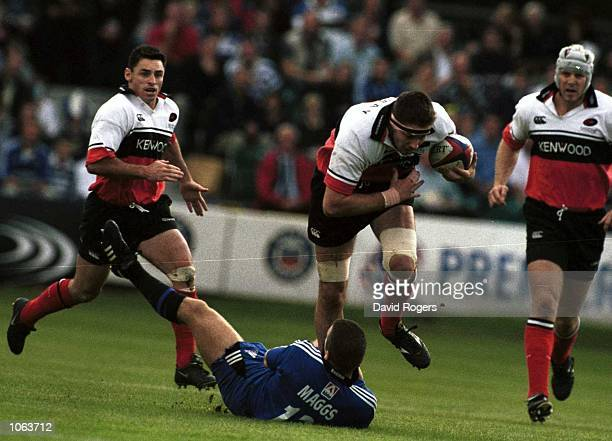 Scott Murray of Saracens tackled by Kevin Maggs of Bath during the Zurich Premiership One match between Bath and Saracens played at the Recreation...