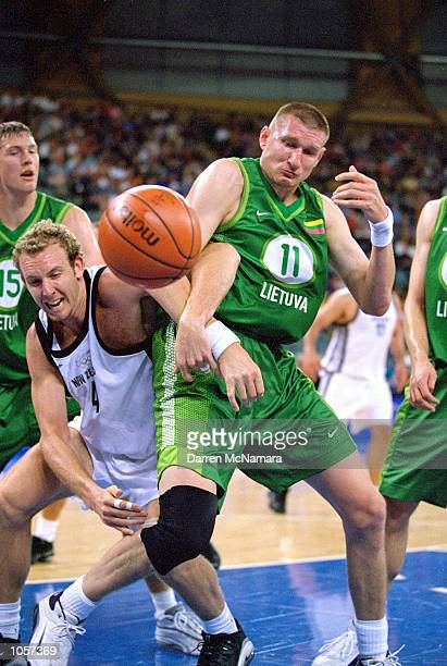 Sean Marks of New Zealand battles with Tomas Masiulis of Lithuania during the Mens Basketball match at the Sydney SuperDome on Day Ten of the Sydney...