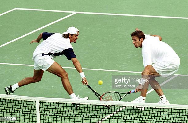 Sebastien Lareau and Daniel Nestor of Canada on their way to victory over Todd Woodbridge and Mark Woodforde of Australia in the mens doubles gold...