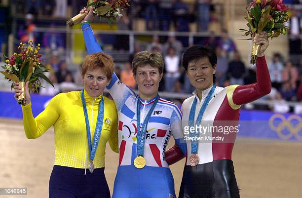 Silver medalist Michelle Ferris of Australia with Gold medalist Felicia Ballanger of France and bronze medalist Cuihua Jiang of China after the...
