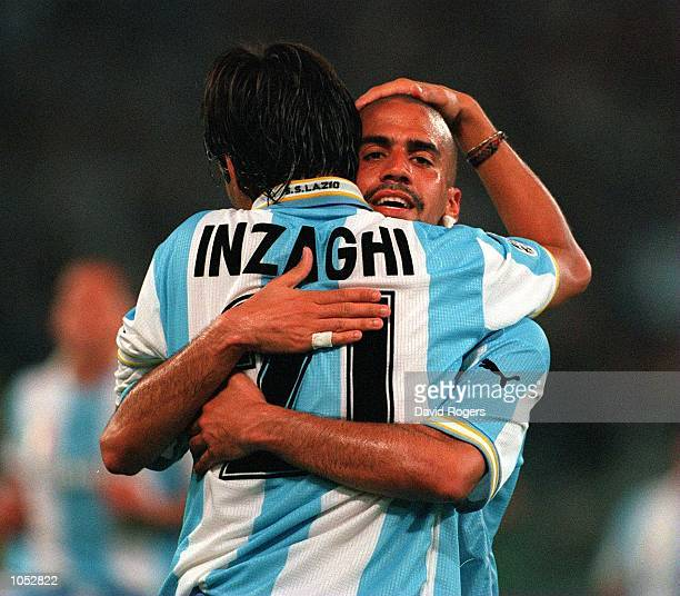 Simone Inzaghi of Lazio celebrates a third goal with teammate Juan Sebastian Veron during the match between SS Lazio v AC Sparta Praha in the...