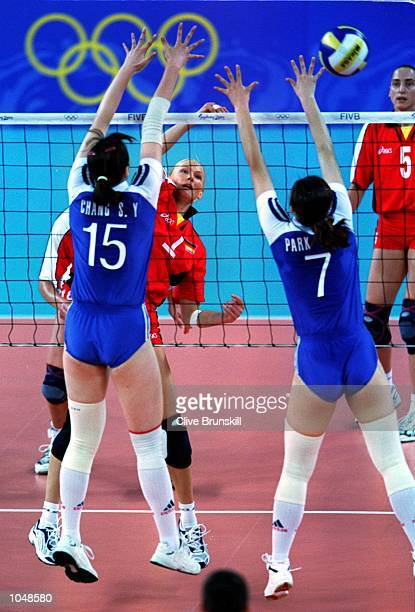 So Yun Chang and MeeKyung Park of Korea combine to defend an attack from Susanne Lahme of Germany during the womens Volleyball preliminaries at the...