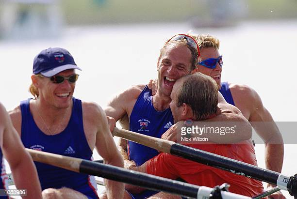 Steve Redgrave of Great Britain is congratulated after winning gold in the Men's Coxless Four Rowing Final at the Sydney International Regatta on Day...
