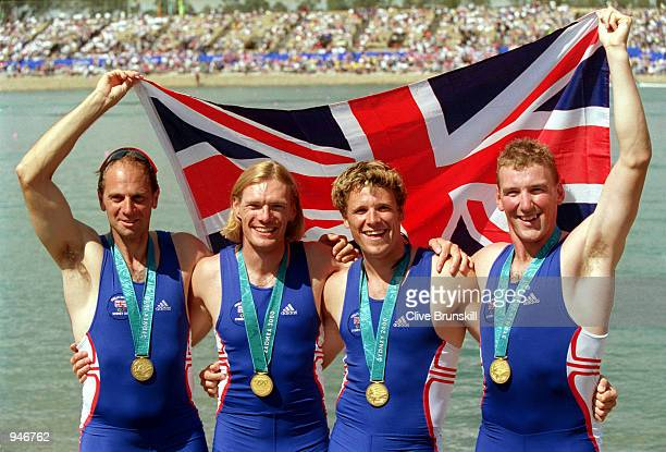 Steve Redgrave Tim Foster James Cracknell and Matthew Pinsent of Great Britain celebrate gold in the Men's Coxless Four Rowing Final at the Sydney...