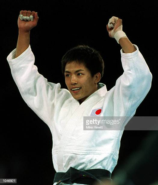 Tadahiro Nomura of Japan celebrates winning the Gold Medal by defeating Bu-Kyung Jung of Korea in the Mens 60 kilogram Judo event at the Sydney...