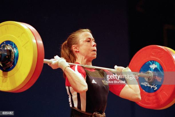 Tara Nott of the USA lifts the bar in the Womens 48kg Weightlifting Event during the 2000 Sydney Olympic Games at the Sydney Convention Centre in...