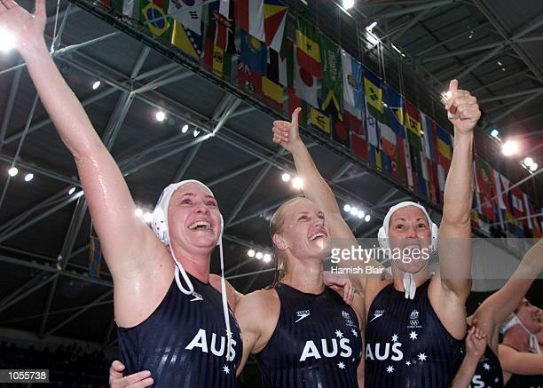 Taryn Woods, Naomi Castle, Debbie Watson of Australia celebrate their Gold medal win, in the Women's Water Polo match between Australia and the USA,...