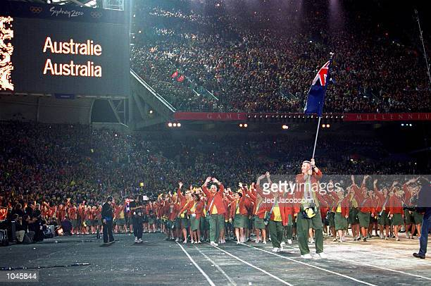 The Australian Olympic Team is led round by Flag Bearer and Basketball competitor Andrew Gaze during the Opening Ceremony of the Sydney 2000 Olympic...